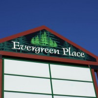 Double faced freestanding sign with dimensional CNC routed trees.