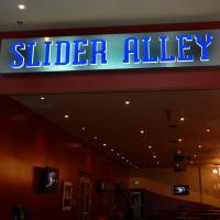 A single faced illuminated interior fascia sign.