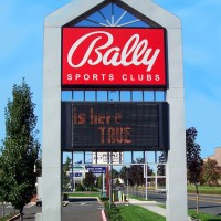 Double faced illuminated freestanding sign with an electronic message center.