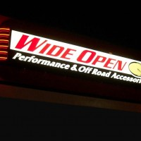 A single faced illuminated fascia sign with neon trim.