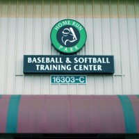 A single face illuminated fascia sign with circular module and internally illuminated cabinet.