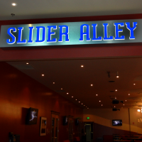 A single faced illuminated interior fascia sign.
