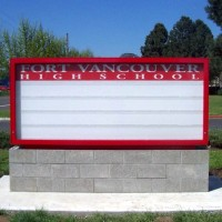 Double faced illuminated monument sign with readerboard.