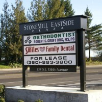 Single faced illuminated multi-tenant monument sign.