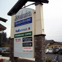 A double faced illuminated multi-tenant freestanding sign.