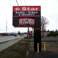A double faced illuminated freestanding sign with an electronic message center.