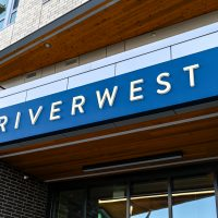 Single faced illuminated wall sign with push through acrylic letters located at the Vancouver Waterfront.